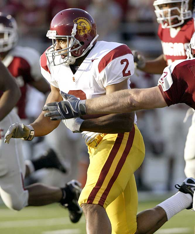 Steve Smith had a career-high 11 catches for 186 yards and two second-half scores as USC escaped Washington State.