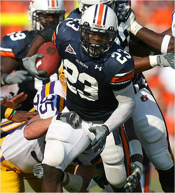 Auburn running back Kenny Irons runs for some of his game-leading 82 yards.