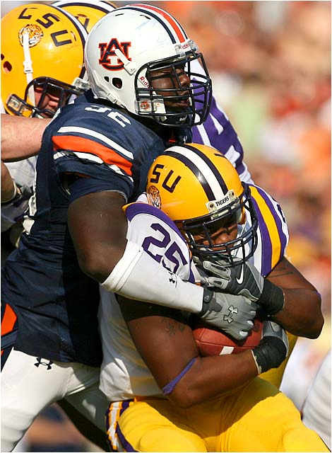 Christopher Browder of Auburn stops LSU running back Justin Vincent cold.