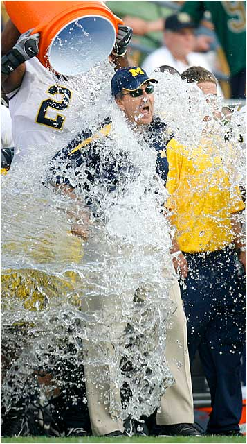 Michigan coach Lloyd Carr gets the traditional bath after a convincing victory over Notre Dame.