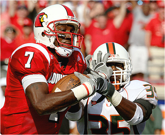 Mario Urrutia holds off Miami's Lovon Ponder on a 56-yard touchdown catch that gave the Cardinals a lead they would not relinquish.