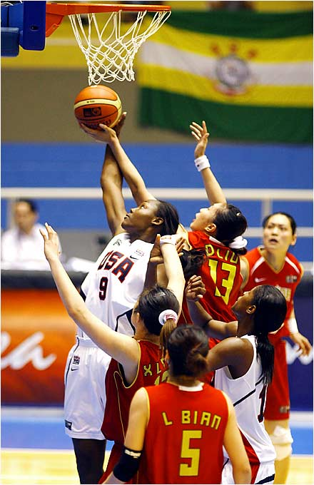 Three days after leading the Detroit Shock to its second WNBA championship, Cheryl Ford was banging with the Chinese in Brazil, scoring five points in 15 minutes of action.