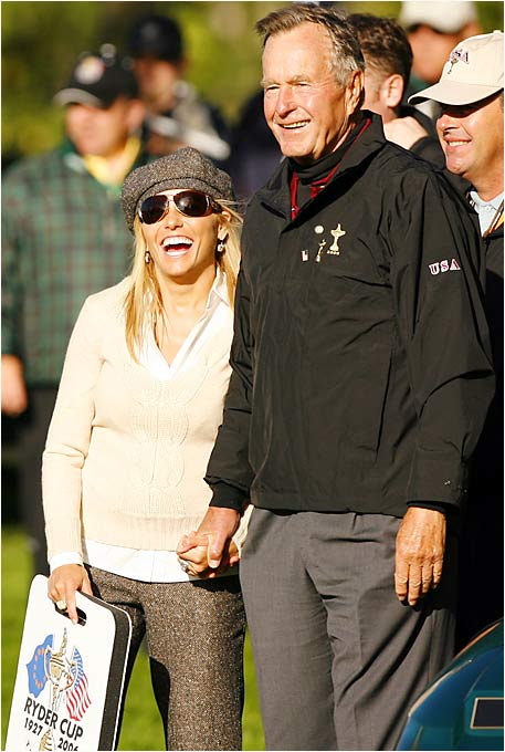 Former President George Bush and Amy Mickelson share a laugh at the Ryder Cup on Friday.