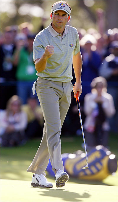 Sergio Garcia won twice on opening day, defeating David Toms and Brett Wetterich in the morning and Tiger Woods and Jim Furyk in the afternoon.