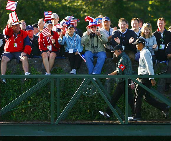 Supporters cheer for Tiger Woods as he crosses a bridge during the morning four-ball match at the Ryder Cup in Kildare, Ireland.