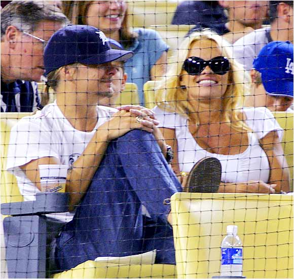 Have newlyweds Pam Anderson and Kid Rock become domesticated? The couple recently took in a Dodgers game.