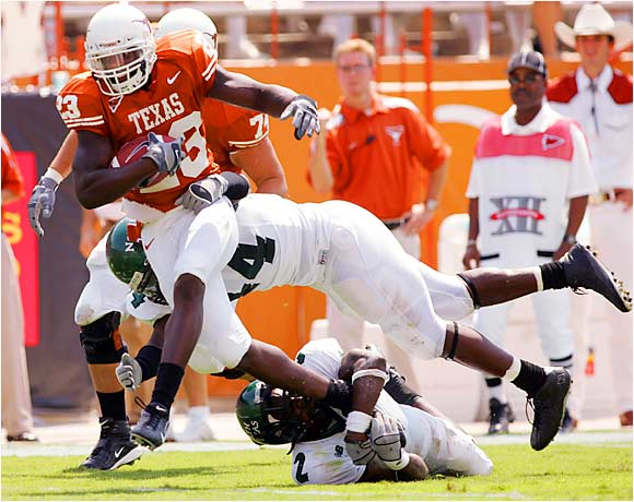 Texas moved the ball with ease against North Texas, scoring two touchdowns in each quarter to decimate the Mean Green 56-7.