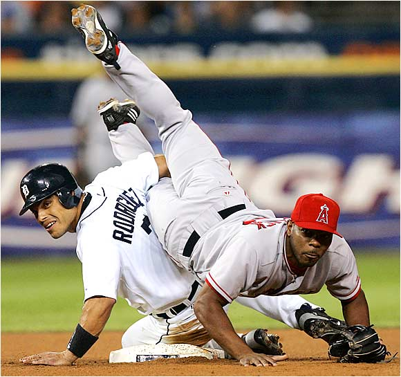 Pudge Rodriguez upends Angels second baseman Howie Kendrick, who successfully turns a double play in the eighth inning at Detroit's Comerica Park on Friday. The Tigers won, 9-0, but have dropped eight of their last 11 games.