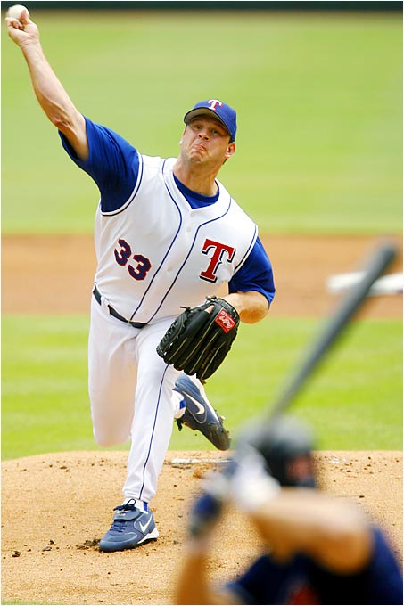 Kevin Millwood of the Rangers delivers to Grady Sizemore of the Indians in the first inning at Ameriquest Field on Sunday.  Millwood allowed one run on two hits while striking out 10, earnimg his 14th win as Texas tripped Cleveland, 5-2.