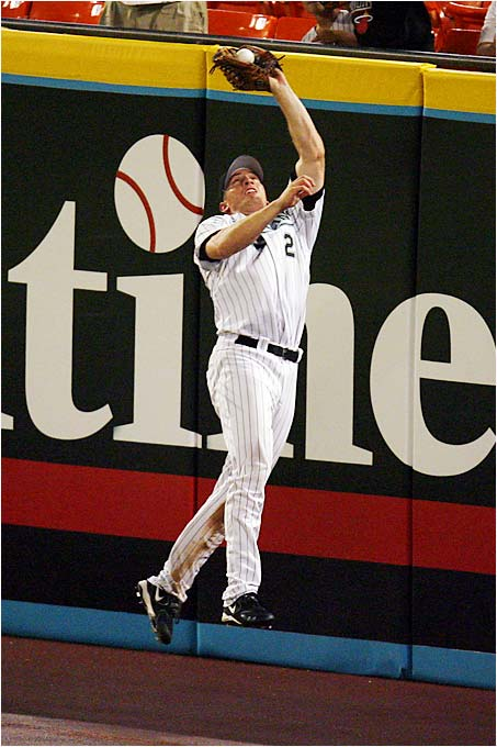 Marlins right fielder Joe Borchard catches a shot at the wall by the Phillies' Jimmy Rollins in the seventh inning at Dolphin Stadium on Sept. 7.