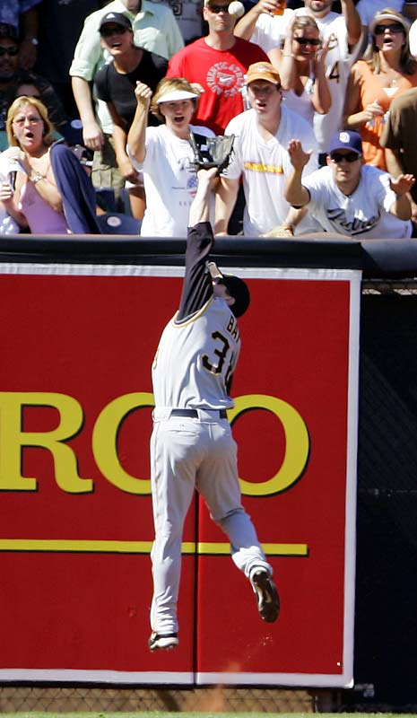 Pirates left fielder Jason Bay robs the Padres' Mike Cameron of a homer in the fourth inning of the Padres' 2-1 victory at Petco Park on Sunday.