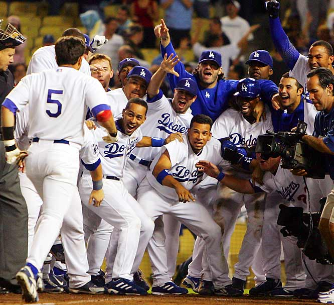 The Dodgers celebrate a walkoff homer by Nomar Garciaparra (5) in the 10th inning that gave L.A. an 11-10 victory over the Padres on Sept. 18. The game went extra innings after Jeff Kent, J.D. Drew, Russell Martin and Marlon Anderson hit back-to-back-to-back-to-back home runs to tie the score in the ninth.