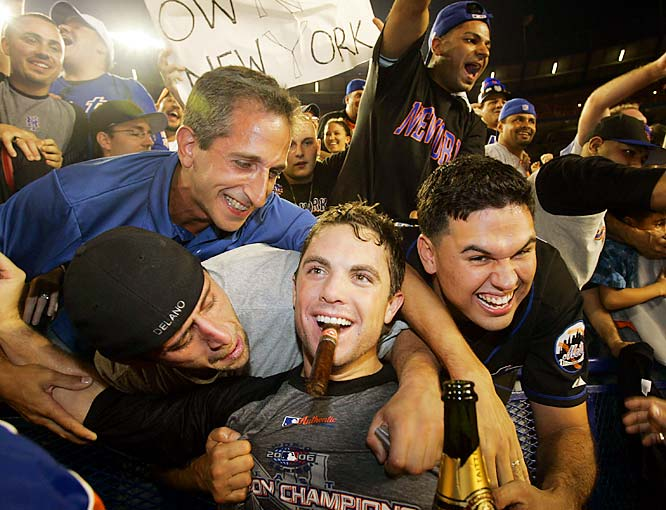 Third baseman David Wright celebrates with fans at Shea Stadium after the Mets clinched the NL East with a 4-0 victory over the Marlins on Sept. 18.