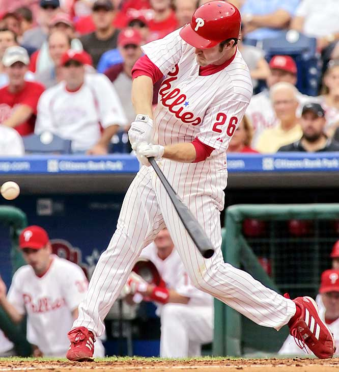 The Phillies' Chase Utley belts a two-run homer off Scott Olsen in the third inning of a 10-7 win over the Marlins on Sunday. Utley batted .538 last week as the Phillies won five consecutive games to take the lead in the NL wild-card race.