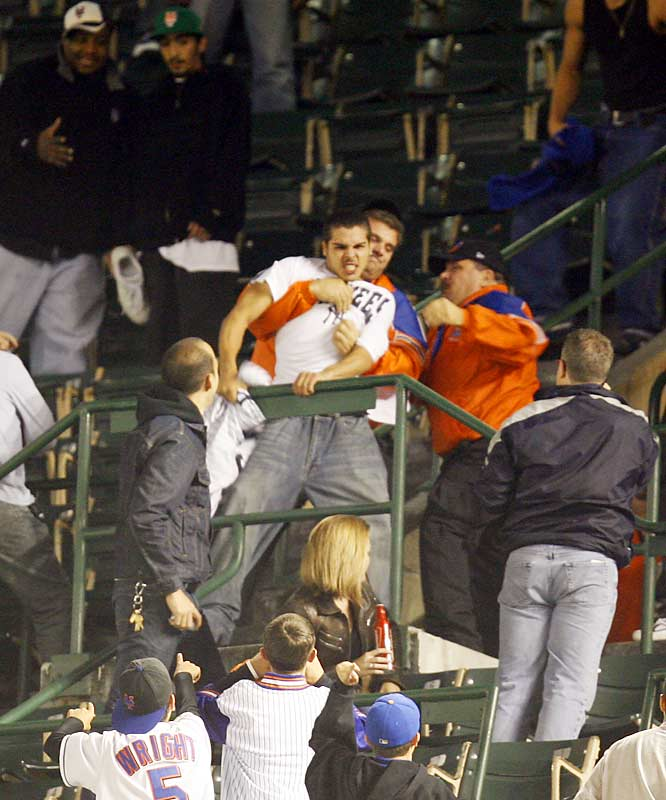 A rambunctious Yankees fan, seemingly out-of-place at a Mets game against the Marlins, is grabbed by security at Shea Stadium on Sept. 21.