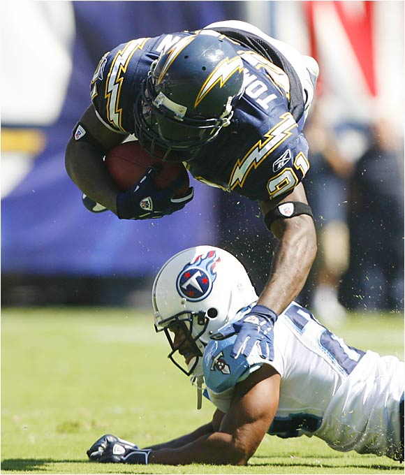 Chargers running back LaDainian Tomlinson rushed for 71 yards and two touchdowns during a 40-7 trouncing of the Titans on Sunday.