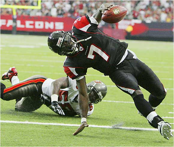 The Falcons' Michael Vick stays on his feet against Derrick Brooks of the Buccaneers for a first-quarter touchdown. Vick had a record 127 yards in Atlanta's 14-3 win over Tampa Bay.