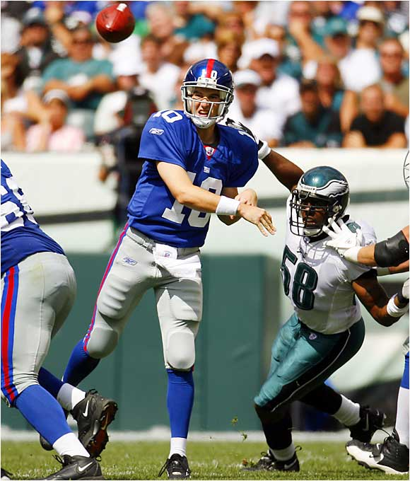 Down 24-7 in the fourth quarter, Giants quarterback Eli Manning rallied his team to defeat the Eagles 30-24 in overtime. Manning threw for 371 yards and three scores, including the game-winning 31-yard touchdown pass to Plaxico Burress.