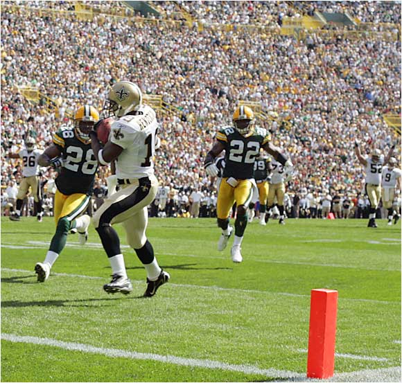 New Orleans' Devery Henderson catches a 26-yard pass from Drew Brees late in the second quarter against the Packers at Lambeau Field.  The Saints won the game 34-27.