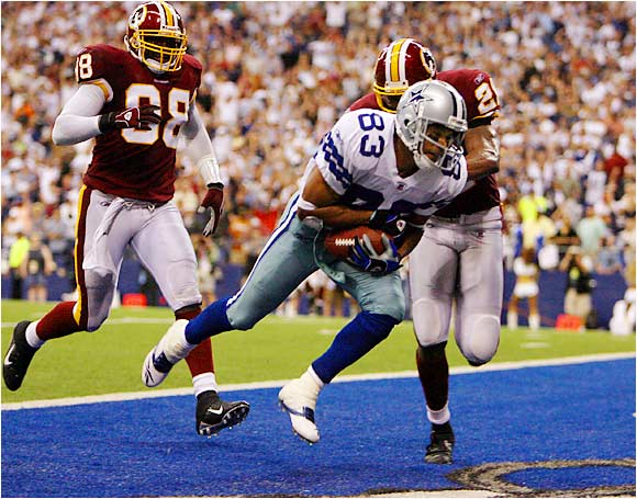 The Cowboys' Drew Bledsoe connected with Terry Glenn for this 40-yard touchdown pass against Redskins linebacker Lemar Marshall (left) and safety Sean Taylor in the fourth quarter.  Dallas beat Washington 27-10
