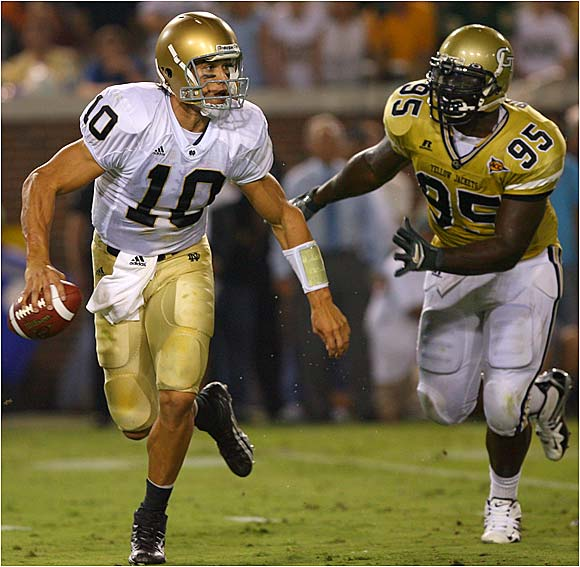 Notre Dame quarterback Brady Quinn eludes Darryl Richard en route to a big night. He was 23 of 38 for 246 yards and one touchdown.