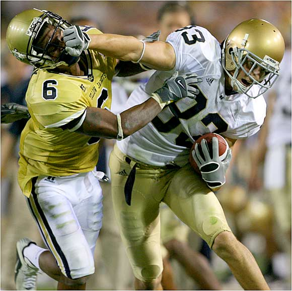 Notre Dame's Jeff Samardzija stiff-arms the Yellow Jackets'  Pat Clark after one of his six receptions.