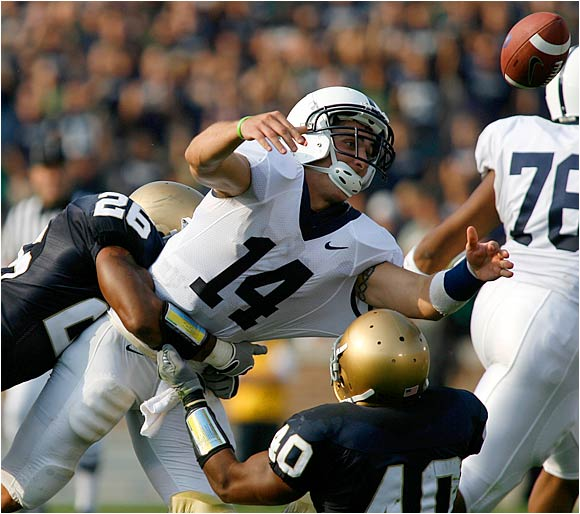Travis Thomas (26) and Maurice Crum Jr. (40) cause Penn State quarterback Anthony Morelli to fumble in the third quarter, leading to an Irish touchdown by Tom Zbikowski.