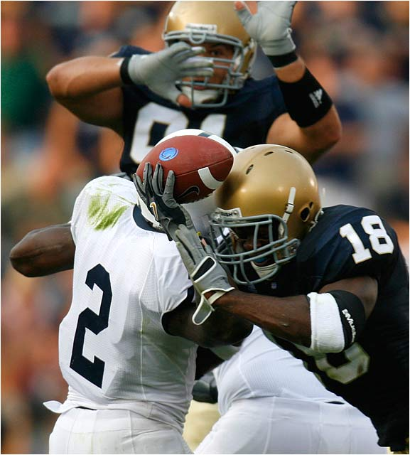 Penn State's Derrick Williams trys to get off a pass while being clobbered by Irish defensive back Chinedum Ndukwe.