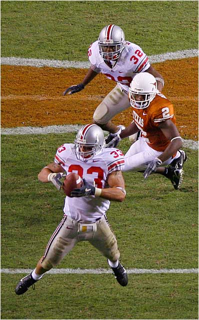 James Laurinaitis, Ohio State sophomore linebacker, picking off pass from Texas quarterback Colt McCoy. The turnover set up a field goal for the Buckeyes.