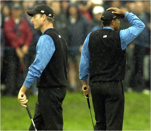 Though they won their afternoon foursome match, Jim Furyk (left) and Tiger Woods couldn't solve Lee Westwood and Darren Clarke in the four-ball, losing 3 and 2.