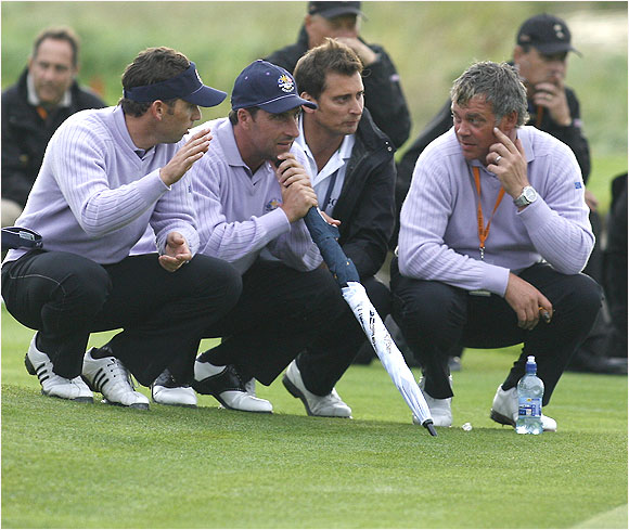 With the Ryder Cup outcome still in doubt, Sergio Garcia (left), Jose Maria Olazabal and Darren Clarke discuss the afternoon pairings at greenside.