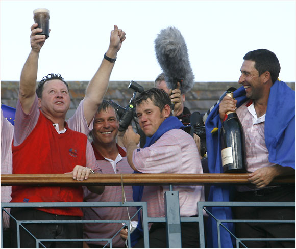 With drink in hand, captain Ian Woosnam gives a champion's salute to the pro-Europeans audience at the K Club.
