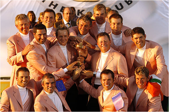 The sun-drenched, beer-soaked Europeans take one last victors' photo with the Ryder Cup trophy.