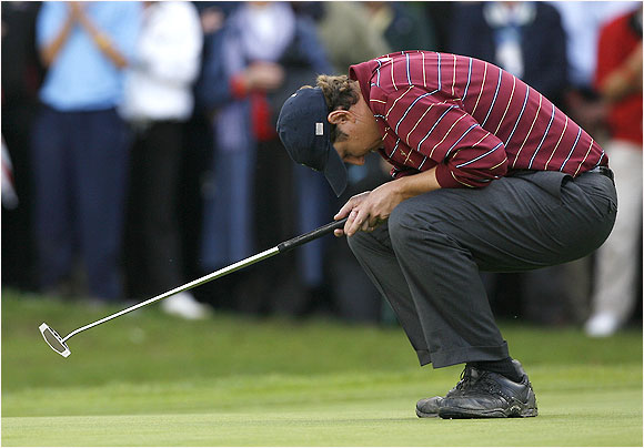 American J.J. Henry agonizes over a missed putt in his singles match with Paul McGinley, which ended in a draw.