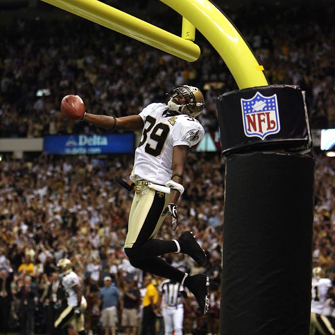 Defensive back Curtis Deloatch celebrates after recovering a blocked punt in the end zone for the unbeaten Saints.