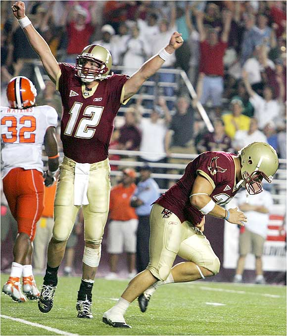 Ryan Ohliger (right) hit a 35-yard field goal in the first overtime and the game-winning PAT in the second OT to seal the Eagles' win.