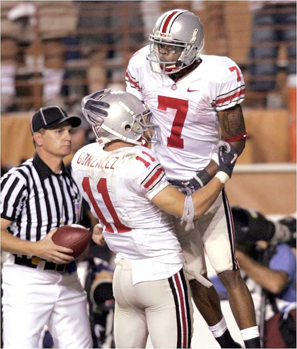 Ted Ginn Jr. (7) hauled in a 29-yard touchdown pass, while Anthony Gonzalez had a 14 yarder as the Buckeyes avenged last year's loss to the Longhorns.