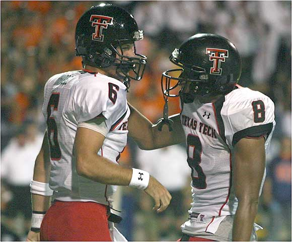 Quarterback Graham Harrell's (left) threw for 376 yards and two scores, one of which went to Joel Filani, who had 169 receiving yards in the win.