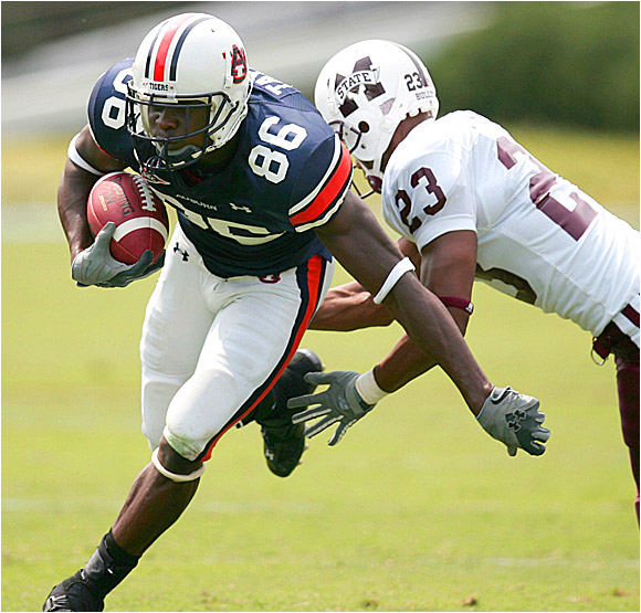 Auburn receiver Courtney Taylor fights past MSU's David Heard in the Tigers' shutout.