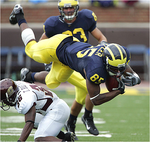 Michigan tight end Carson Butler Jr. -- who had three catches for 26 yards -- is upended by Central Michigan's Terrance Robinson.