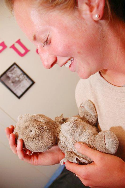 Kara holds the team's unofficial mascot, Kowaly, a stuffed animal that once looked like a koala, but several reconstructive surgeries and two decades later, is barely hanging on to its original shape. Kowaly has traveled to Italy, Brazil and even attended spring break at Daytona Beach.