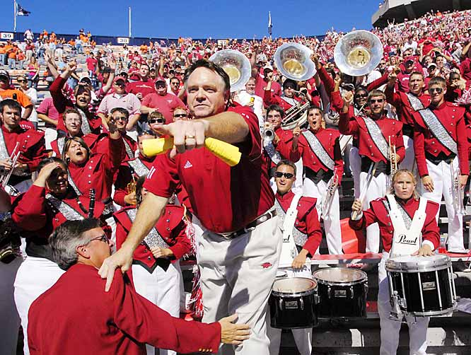 An ecstatic Houston Nutt pointed to his team after climbing into the stands to lead the band in singing the school fight song after Arkansas' victory over Auburn.