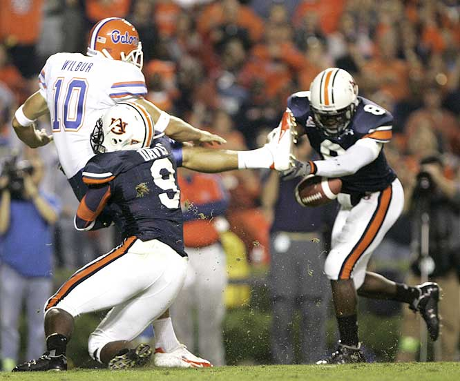Jerraud Powers (8) blocked a punt that led to the Tigers' go-ahead touchdown as they beat the SEC's last remaining unbeaten.