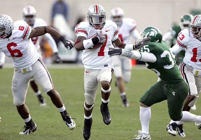 Ted Ginn Jr. (7) had a 60-yard punt return for a touchdown, the sixth of his career, as the Buckeyes extended the nation's longest winning streak to 14 games.
