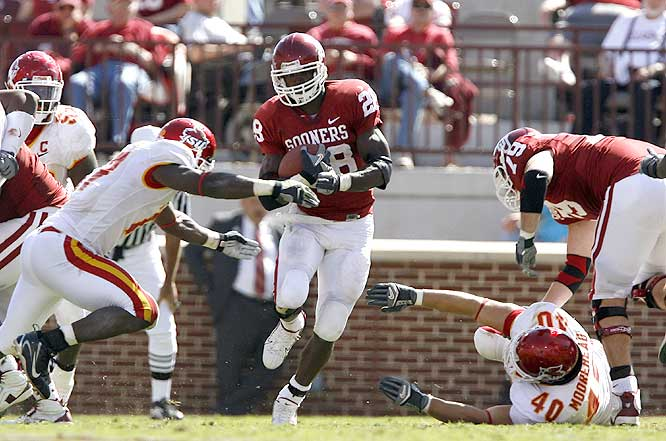 Adrian Peterson ran for 183 yards and two touchdowns in OU's win, but broke his collarbone diving into the end zone on a 53-yard run, likely ending his season.