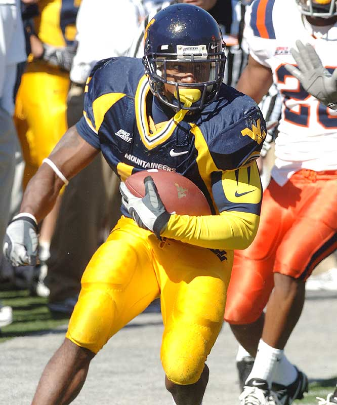 Steve Slaton ran for 163 yards and a touchdown as the Mountaineers piled up 457 rushing yards in extending their winning streak to 13 games.