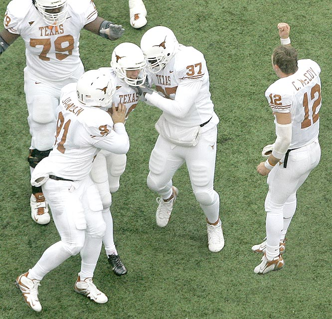 Ryan Bailey (center) nailed a 22-yard field goal with 23 seconds remaining to lift the Longhorns to victory in Lincoln.