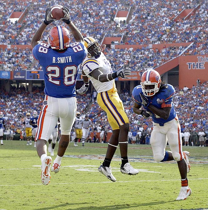 Gators cornerback Ryan Smith makes an interception during the second quarter.