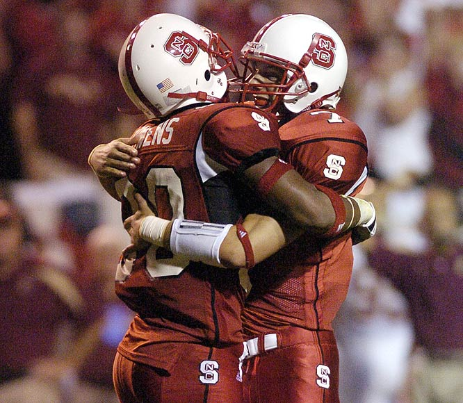 Daniel Evans (right), who completed 13-of-22 passes for 190 yards including three touchdowns, celebrates after the Wolfpack's huge win over the Seminoles.