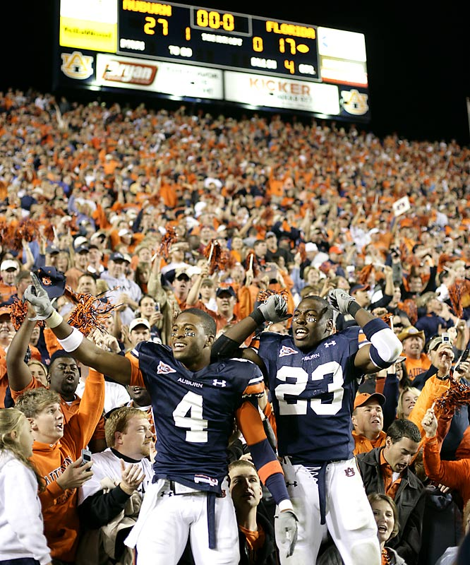 Brothers David (left) and Kenny Irons celebrated Auburn's 27-17 upset over Florida in front of the home fans at Jordan-Hare Stadium.
